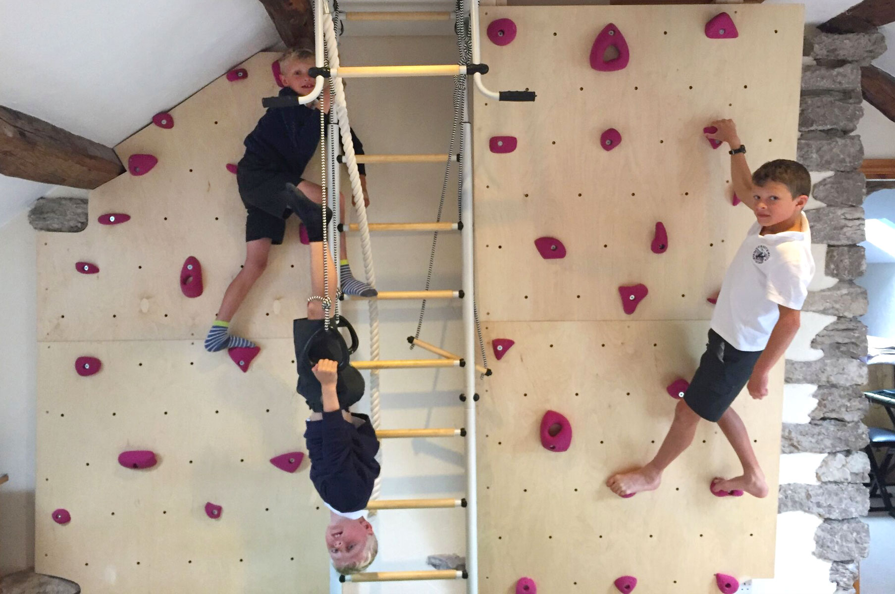 Boys climbing bedroom wall